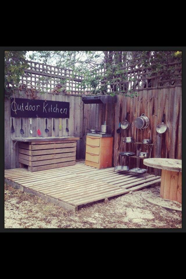 Mud kitchen - love the pallets used for the flooring, great way to keep the floor tidy, as it can be swept up (another great life lesson.)