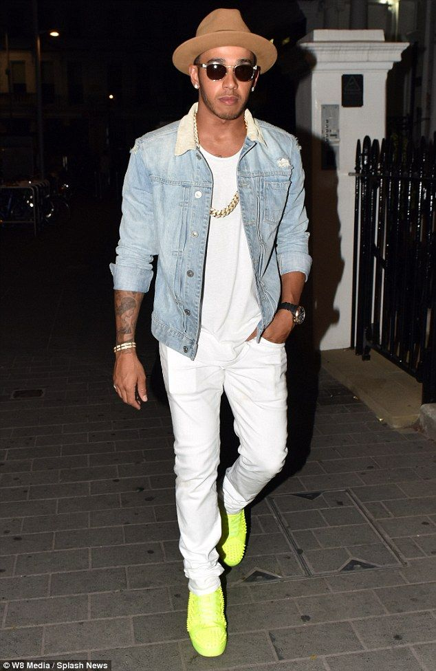 Not such a style winner: Lewis Hamilton stepped out in a pair of zany fluorescent trainers...