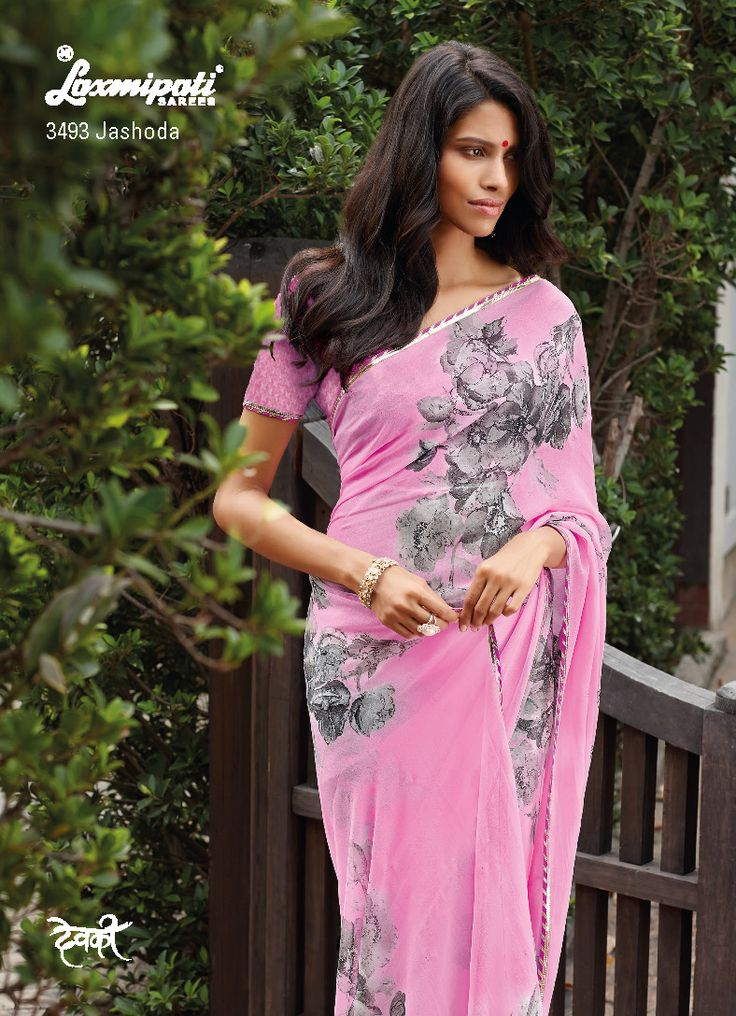 On pink color base, Gray floral bunch is decorated. The matching beautiful pink brasso fabric blouse is perfectly compliment to this beautiful saree.