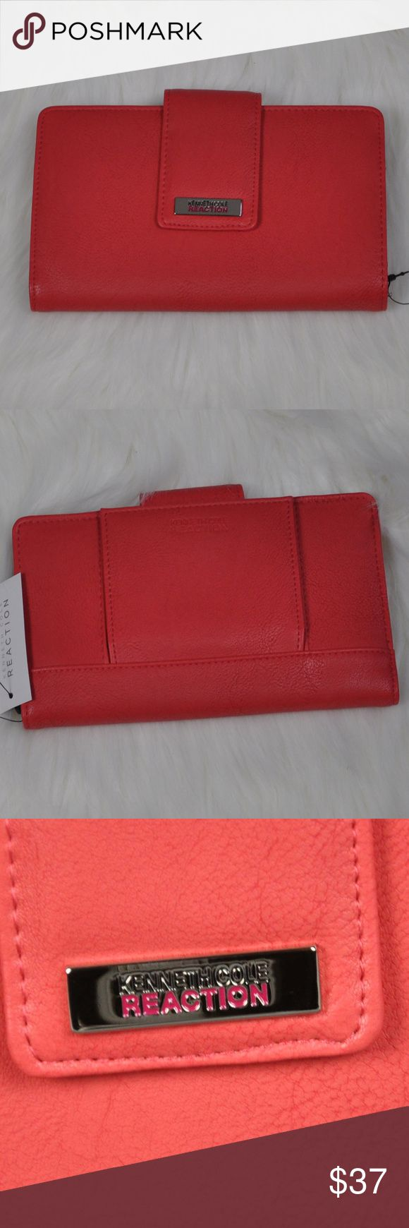 """NWT Kenneth Cole Reaction Salmon Utility Clutch Kenneth Cole Reaction Salmon Utility Clutch Wallet 194534/717 is new with tags.  Faux Salmon colored leather Back Snap has mirror and slot for ID Main compartment has three zippered pockets 5 card slots  1 id slot 3 full length slots one behind the zipper pocket  7.5"""" Wide x 4.5"""" Tal (5 including flap) x 1"""" Thick  Smoke free pet friendly home  Internal SKU: UTILITYSA1  This Kenneth Cole Reaction Salmon Utility Clutch Wallet is stylish and has…"""