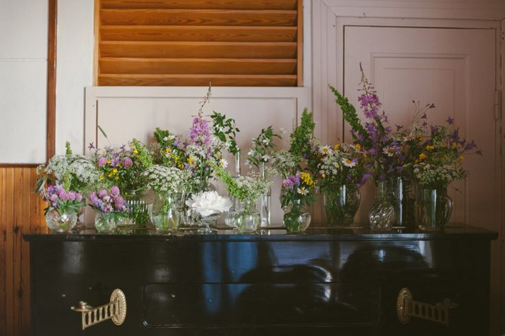 For a summer wedding, save money and decorate with wild flowers in mismatched vases. Julia Lillqvist | Amanda and Ruben | Sibbo bröllopsfotograf | http://julialillqvist.com