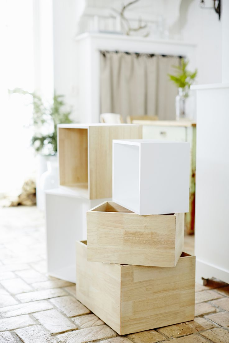Painted wooden boxes.  http://www.anza.co.uk/tips-and-inspiration/articles/box-shelving