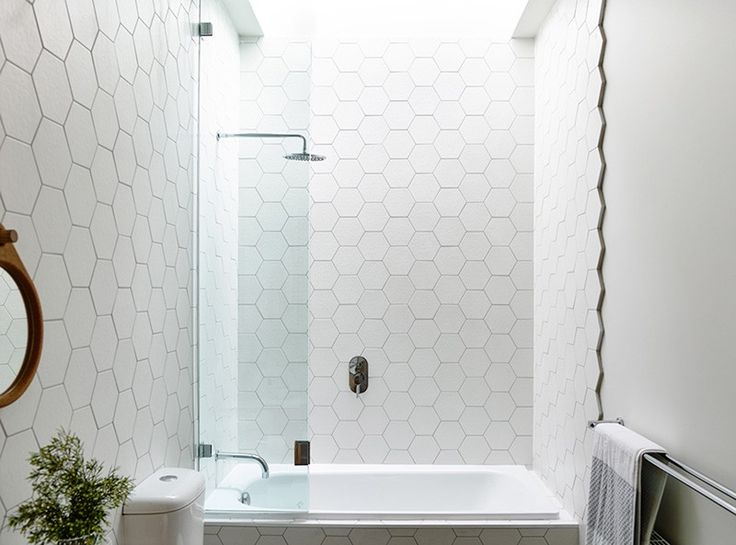 Design Detail: Hexagonal Tiles On A Bathroom Wall. Love the way the tiles are finished off, better than cutting them straight