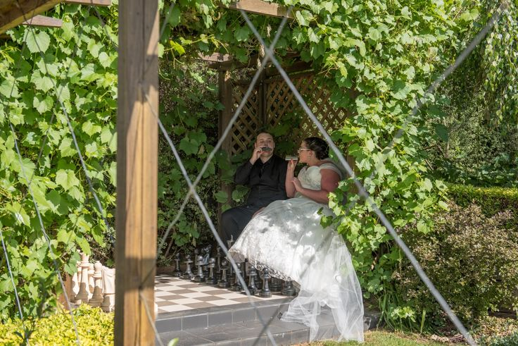 Wedding photographer Candid Photos of a Lifetime captured the bride & groom having a sneaky drink at the chess board in Gairloch Garden Oberon  www.candidphotosofalifetime.coma.u