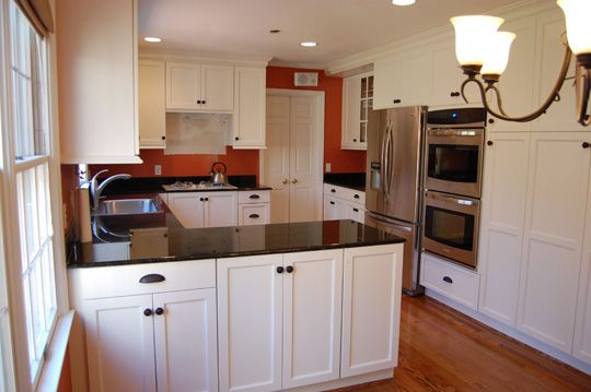Finally a kitchen with red walls like ours! We need white cabinets #