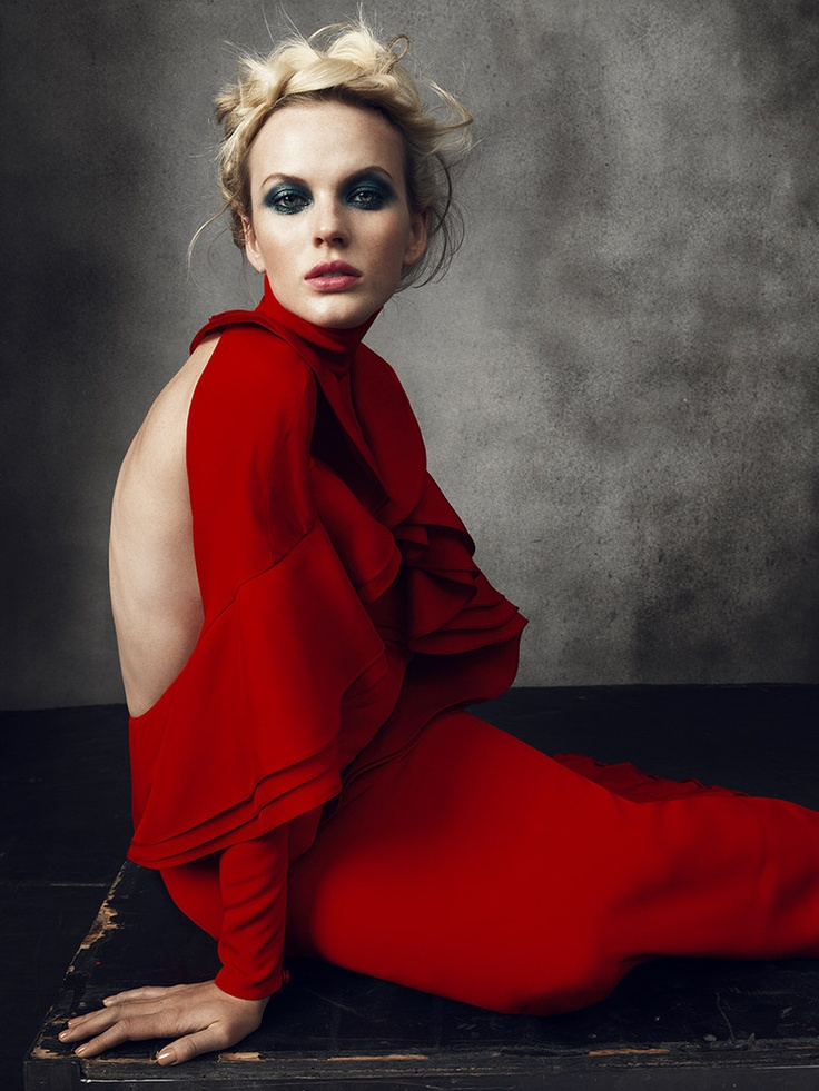 Anne Vyalitsyna in a beautiful blood-red gown, dramatic make-up, and braided hair (by Norman Jean Roy)