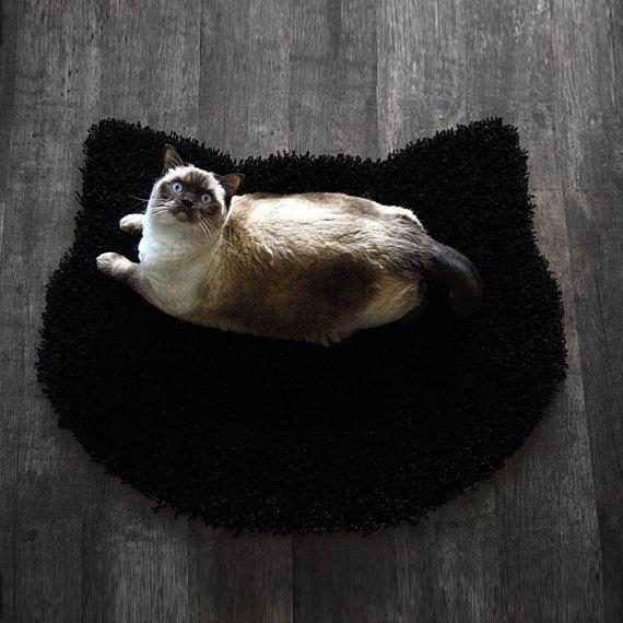 He encontrado este interesante anuncio de Etsy en https://www.etsy.com/es/listing/109006257/mullida-alfombra-negra-forma-de-la