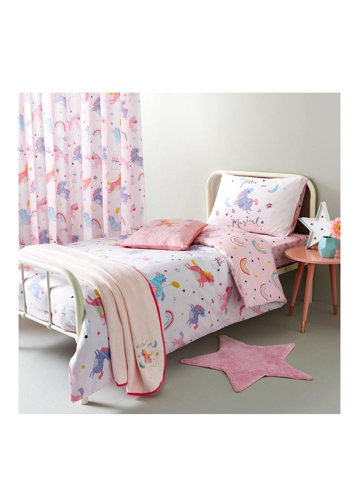 Catherine Lansfield Magical Unicorns Cotton Rich Duvet Cover and Pillowcase Set Bring a fairy-tale feel to her space with this single duvet cover set from the gorgeous Magical Unicorns bedding range. Pretty in pastel tones, it's covered in unicorns, castles and rainbows, all against a fresh white background. The reverse features polka dots and stars along with lots more rainbows, set on a beautiful pink canvas. The cotton-rich fabric means it has the soft comfort of cotton, along with the…