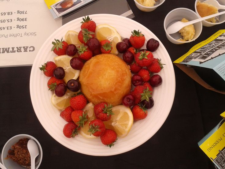 our delicious @cartmelsticky Tangy Lemon Drizzle sponge pudding with summer fruits, perfect with lashings of cream