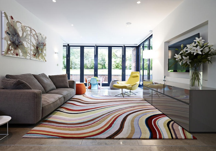 CURVED DEF: Curved lines make space look graceful and mimics lines found in nature. WHY: I chose this photo because it immediately draws your eyes to the curving carpet that gives the room a smooth feeling.