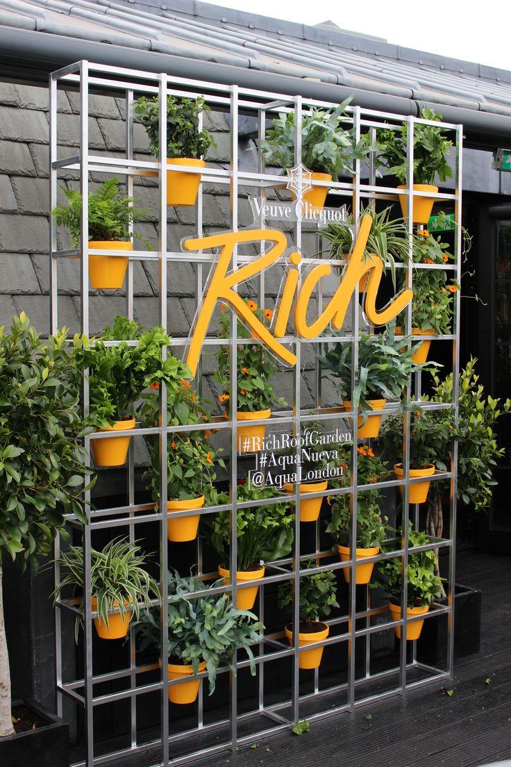 Living flower walls and a rooftop bar installed for Veuve Clicquot #windowdisplay #retaildesign #visualmerchandising #design #creative #vm #rooftopbar #livingwall #flowerwall #industrialgardening