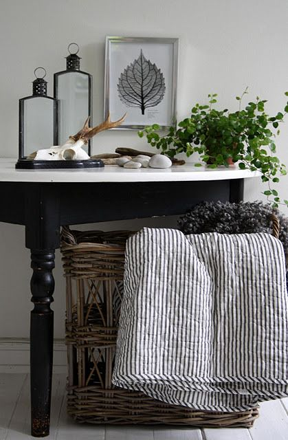 Scandinavian design has beautiful, clean lines and contrasts. Love the rustic antlered skull and pinecone touches.