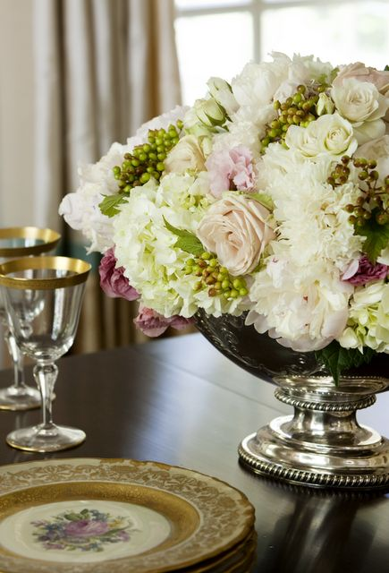 silver pedestal bowls and full fluffy flowers... this arrangement looks incredibly similar to what I picked for my own wedding :)