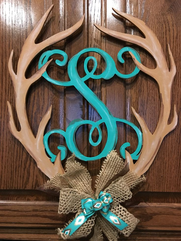 Wood monogrammed lettering  enclosed with antlers made for my mom. Visit my etsy page ARHCreativePassions!