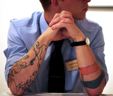 Pinning this simply because business attire + tats = sexy.