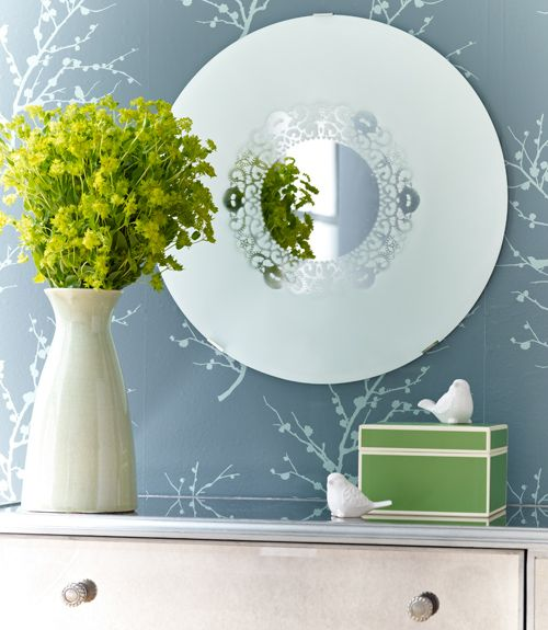 Upcycle an old mirror with spray paint and a doily