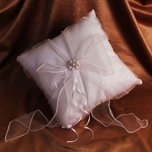 """Add extra elegance to your wedding ceremony with a little help from Ruby Blanc! Our """"Pure Satin"""" ring bearer pillow is the perfect pillow for your ring bearer as he walks down the aisle.  #wedding #ringbearer #partysupplies #party #rubyblanc"""