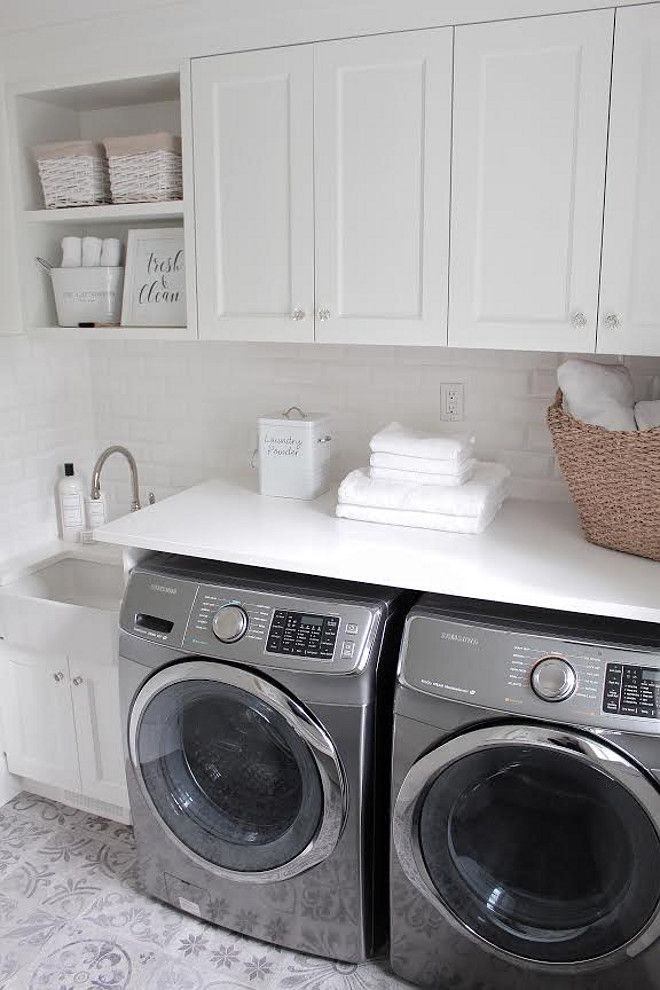 Laundry room with cement floor tile. Tile is from @porcelanosa_grupo. JShomedesign