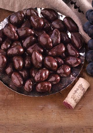 For the mom who wants to relax after a long day with some wine AND chocolate... Chocolate-Covered Wine Grapes (I can get better images from PR)