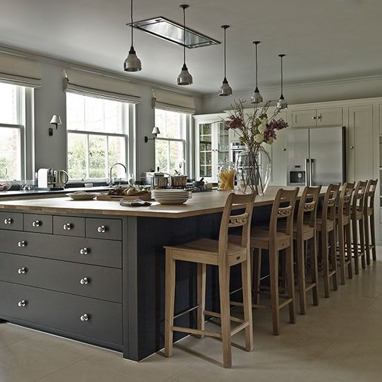 The focal point of the kitchen is a vast, double-depth island with a painted base and wooden worktop, incorporating a hob and wine fridges. Homes & Gardens | http://www.housetohome.co.uk/house-tour/picture/explore-this-immaculate-country-home-in-hertfordshire/2