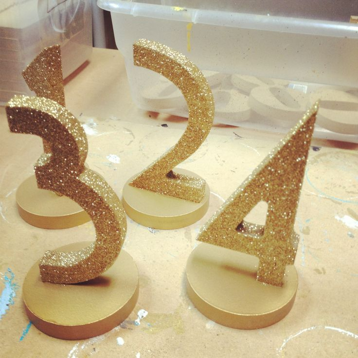 glittery gold wedding table numbers not as rustic bc of font but cool idea