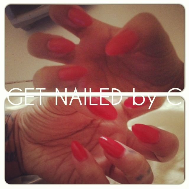 Get nailed by C - CND gel nails in red, almond shaped.