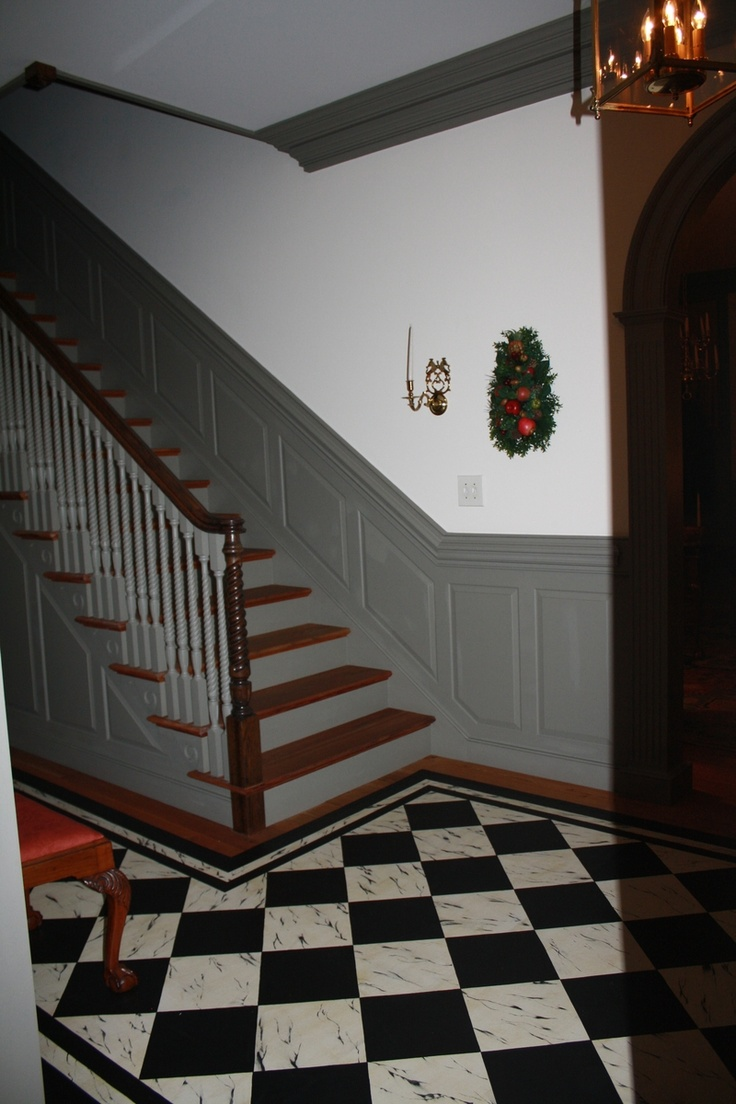 FARMHOUSE – INTERIOR – The staircase and wainscoting are beautiful.