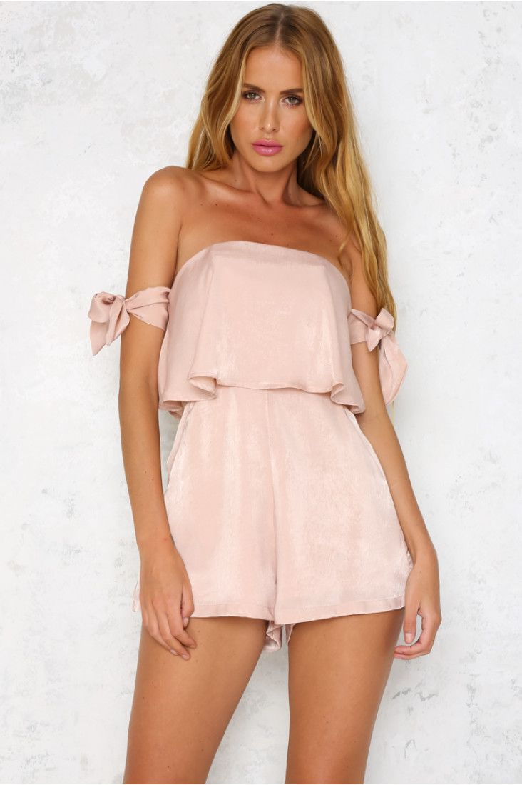 Looking for the perfect date night outfit? You won't be able to look past our strapless Island Life Playsuit! This gorgeous playsuit features partial boning at the side seams and side pockets at the waist. An exposed zipper at the back makes it easy to wear. Complete your outfit with a pair of nude lace up heels.  Beige playsuit. Lined. Cold hand wash only. Model is a standard XS and is wearing S. True to size.  Non stretchy fabric. Polyester.  Runs small, recommended to go a size up.