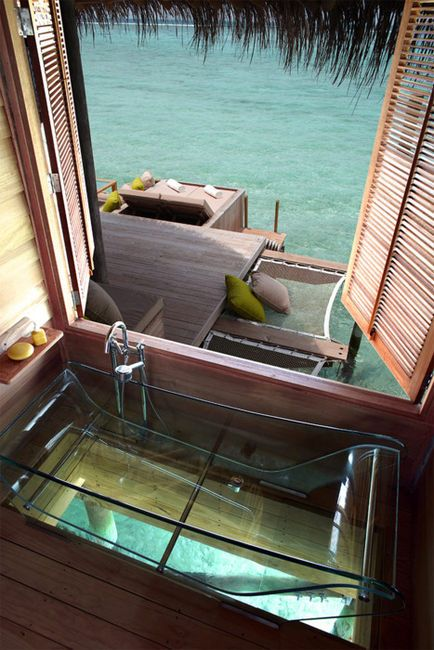 """It would be cool to have an entire house on stilts in shallow water. But a glass bottom tub over the water takes it to a whole new level. Gives new meaning to """"swim with the fishes"""", LOL!"""