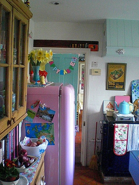 Cute, colorful kitchen. My fridge would be a different colour though.