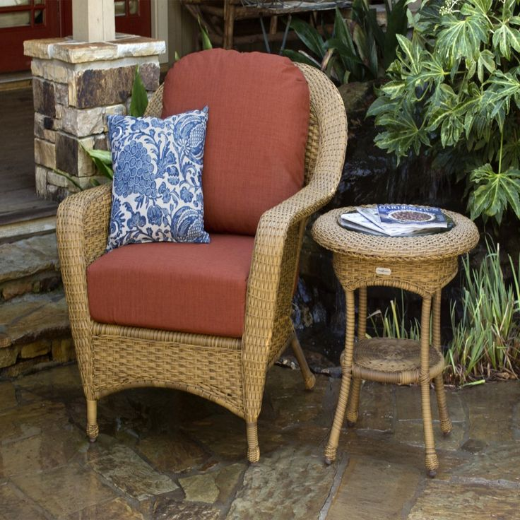 Classic Tiled Patio With Red Chair Cushion, Blue White Decorative Outdoor  Pillow, And Brown