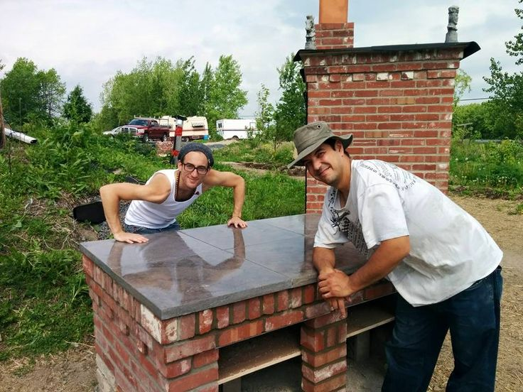 Chef X & our Master Mason in Front of our New Kitchen Counter  #Kitchen #outdooroven #Urbanfarm #urbangardening #sustainable #permaculture #valhallamovement #montreal  Visit our website at : http://valhallamovement.com