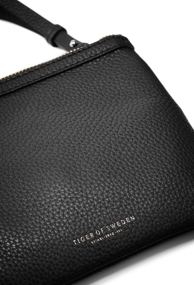 Ortisei bag-Women's cross body bag in soft napa leather. Can be used as clutch. Zip closure with leather zip pull; shoulder strap; embossed Tiger of Sweden logo. Size: 20 x 15 cm