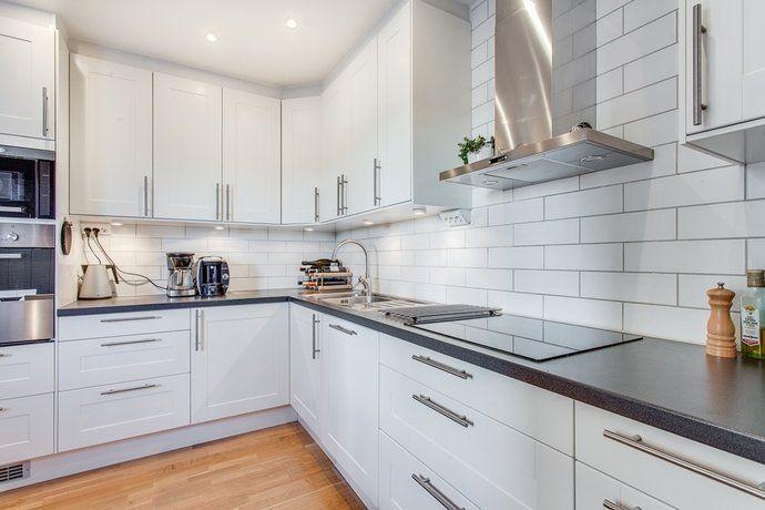 Swedish kitchen wood floor white black