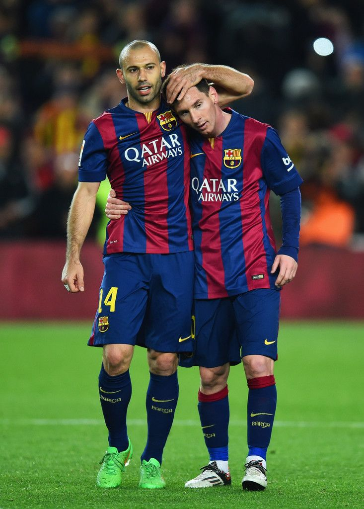 Javier Mascherano and Lionel Messi of Barcelona celebrate victory after the La Liga match between FC Barcelona and Real Madrid CF at Camp Nou on March 22, 2015 in Barcelona, Catalonia.