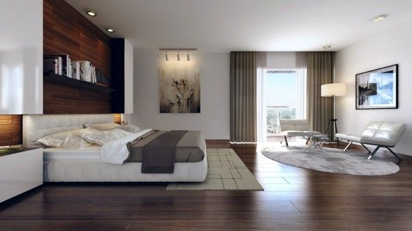 Area rugs manage to separate areas of this large bedroom so it feels like more than one useable space.