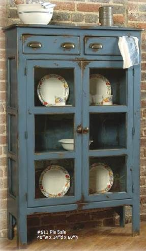 A pie safe similar to this, next to a jelly cupboard, in coordinating (monochromatic) colors - two or three side by side in the dining room of our 1950's ranch style Michigander house.