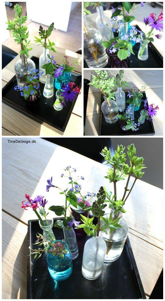 festligt og naturligt bordpynt - blomster og grene på spisebordet