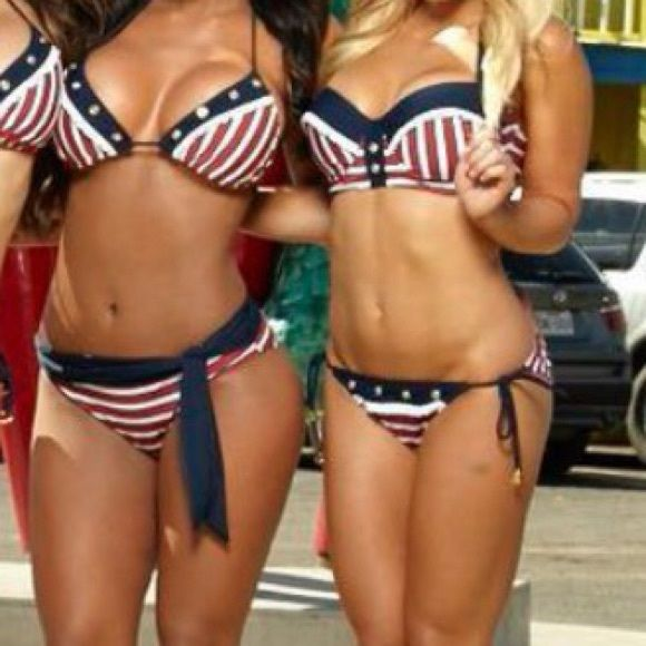 American flag bikini Ties back. Cute gold sailor charms on ties. Gold rhinestones decor on top rim. XS top/S bottom. Wore 1 time at shoot. Red White & Blue  you'll look the cutest this 4th of July! Red carter Swim Bikinis