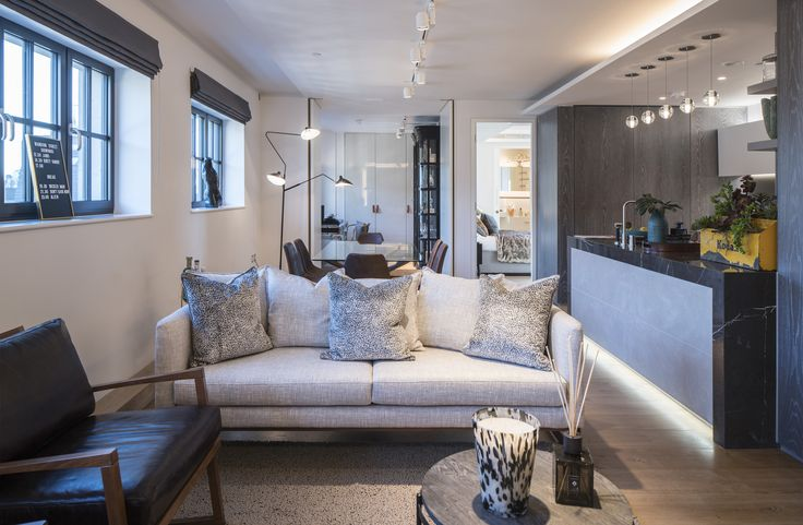 These lustrous viscose velvet Zinc Textile scatter cushions in Animalia design add a glamorous touch to this contemporary living space - complemented by the luxurious wool rug in neutral tone, providing rich comfort.  #interiordesign #luxurylife #luxury #london #luxuryproperty #luxuryhomes #londonproperty #luxuryinteriors