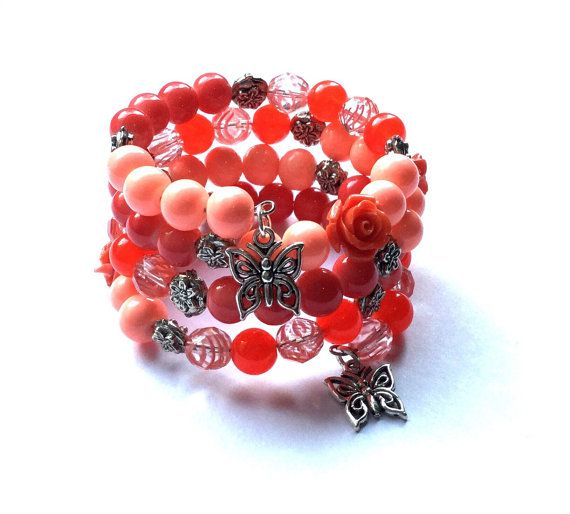 Peach and coral memory wire bracelet with butterfly charms