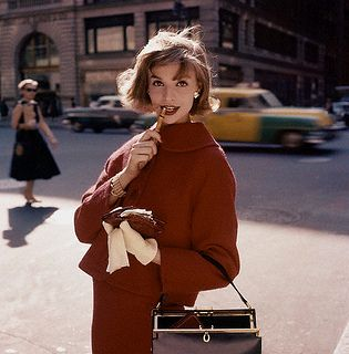 Stylish in crimson on the streets of New York, 1957. #vintage #fashion #1950s