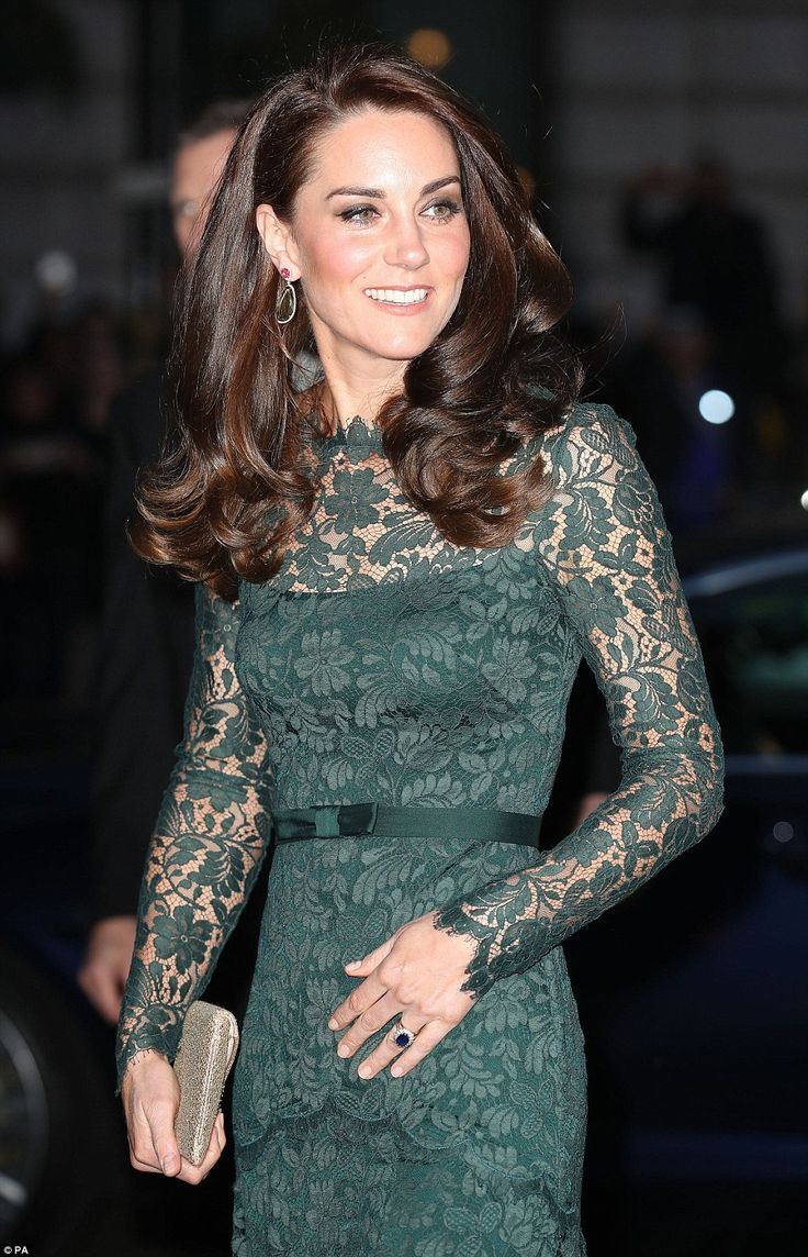 Kate's famously glossy brunette locks were styled in an especially bouncy flurry of curls...