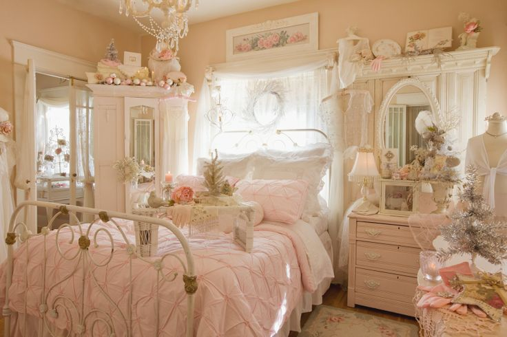 Love this shabby chic bedroom! Cottage style, pink and chippy white, iron bed, vintage accessories.