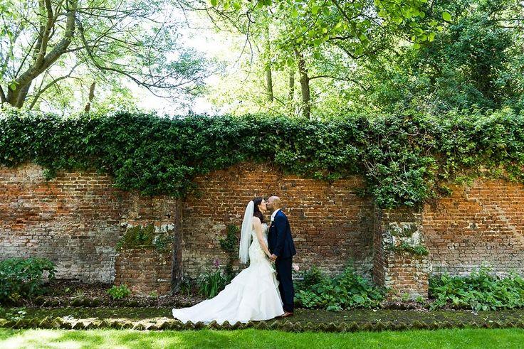 Stunning walled garden wedding portrait. Leez Priory Essex © Fiona Kelly Photography