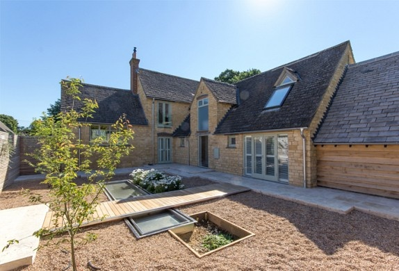 stone, weatherboard and a courtyard