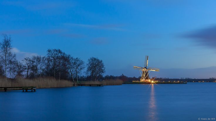 https://flic.kr/p/E2B4iD | De Helper @blue hour | Mill De Helper located at the Paterswoldsemeer at blue hour. It was cold and windy and when I wanted to leave, the lights of the mill went on, so I stayed a little bit longer... brrr...  More information:  nl.wikipedia.org/wiki/De_Helper  Thanks to everyone who takes the time to comment and/or fave.  © Koos de Wit All rights reserved. Please don't use this image without my permission. www.koosdewit.nl