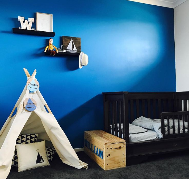 Sail Boat design sitting nicely on the shelf in this boys room Hammer & Twine