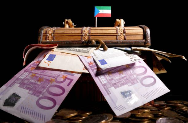 equatorial guinea flag on top of crate full of money