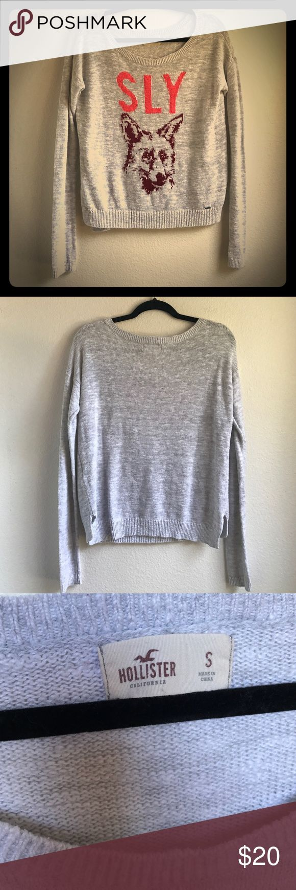 """""""Sly Fox"""" Sweater by Hollister Co. Be extra cute, cozy, & clever, you sly fox you! In a lovely light side of gray with the font """"sly"""" in a shade of orange and the image of a fox.  Great for layer with your favorite bralettes, tanks, and accessories. 💁✨Women's Size SMALL. In EXCELLENT condition. Open to only reasonable offers for single purchase items. Hollister Sweaters"""